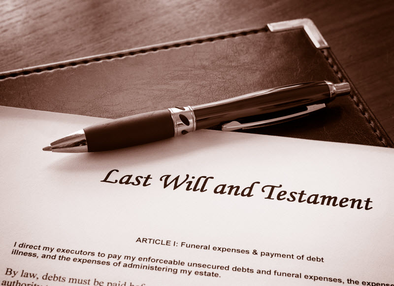 Will and testament document and a pen