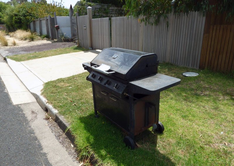 Old BBQ griller in the street