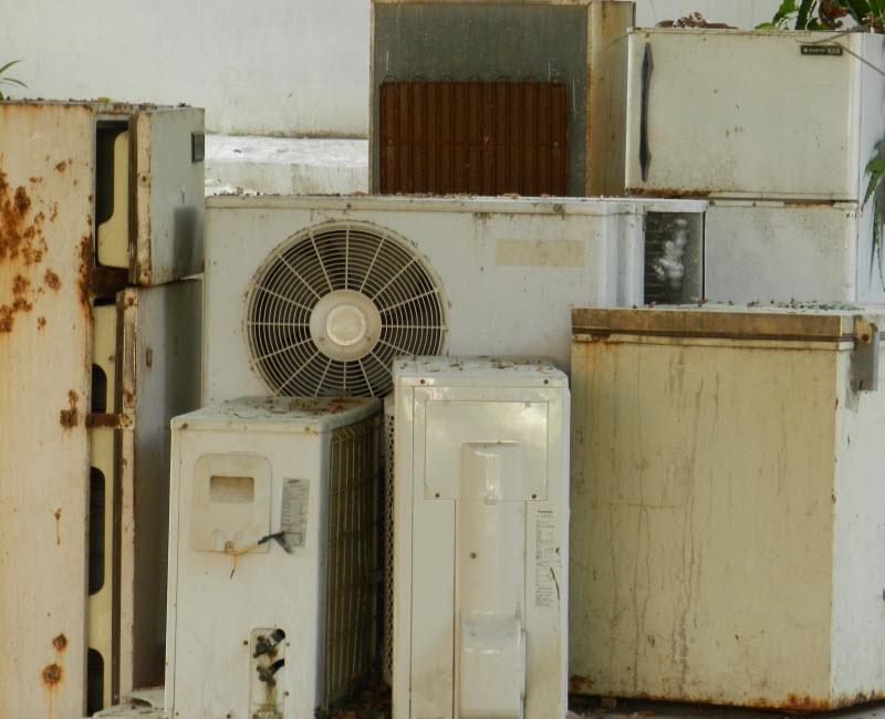 Old rusty air-conditioner, refrigerators
