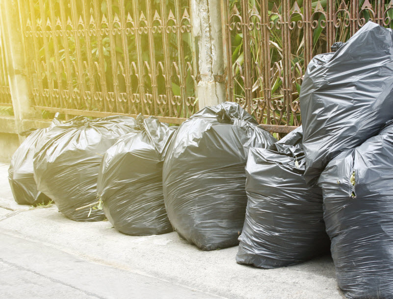 Garbage bags placed outside the home