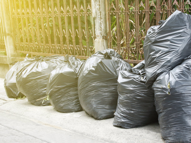 Garbage bags outside the house