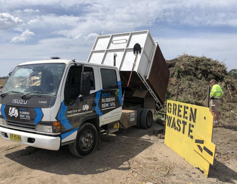 Truck bin getting green waste