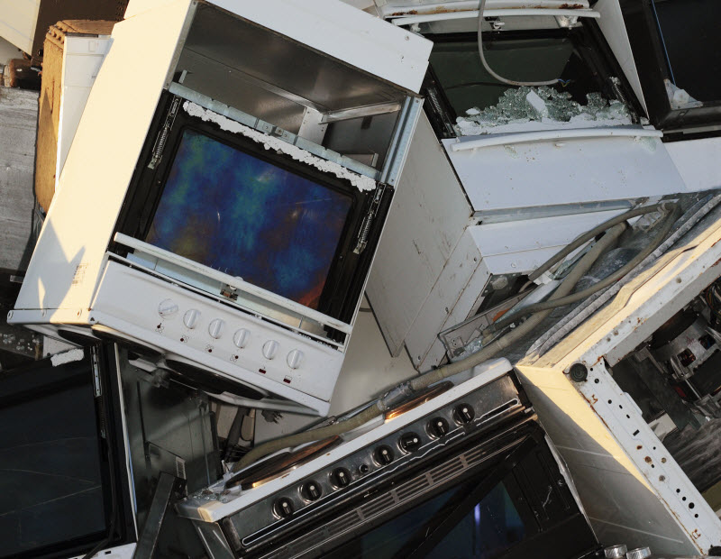 Pile of broken washing machine, refrigerators