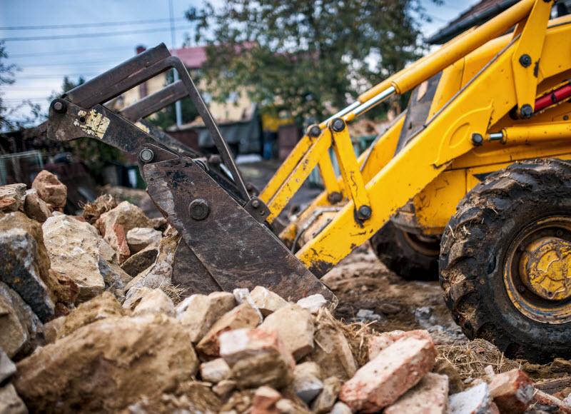 Bulldozer removing pile of debris