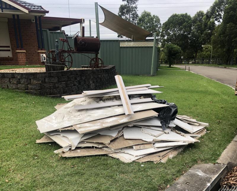 Piled broken plywood at the backyard