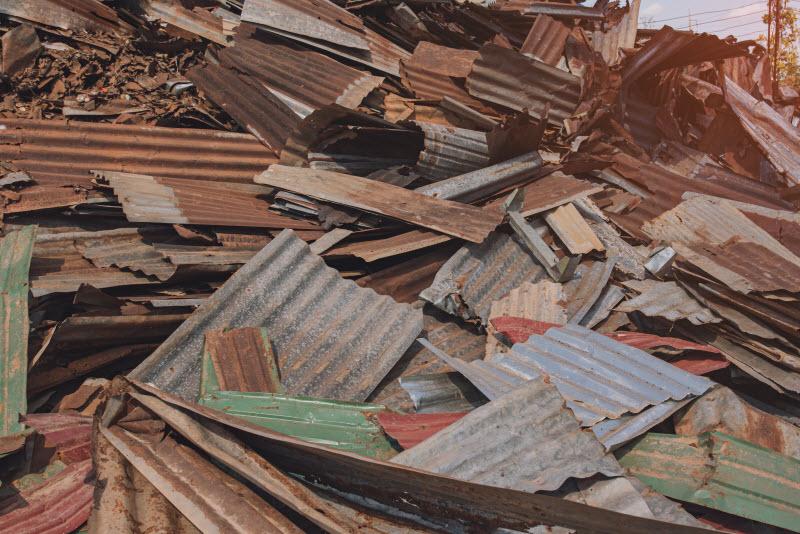 Dumped rusty broken roofs