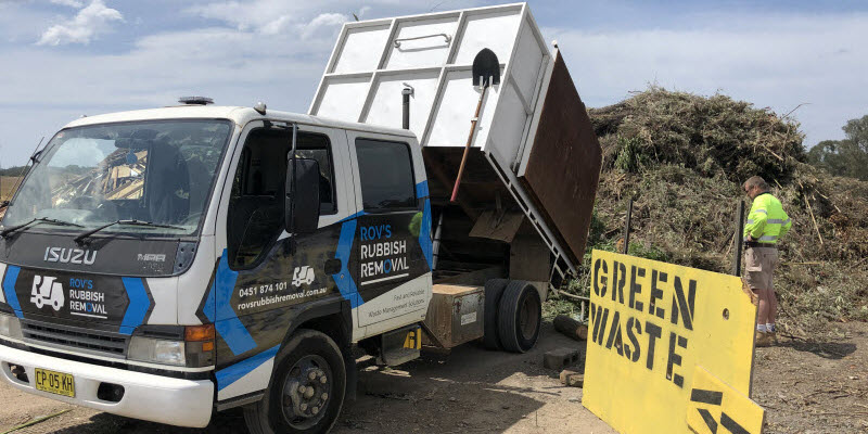 Truck of rubbish in a green waste area