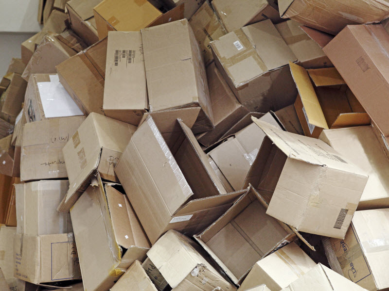 Discarded brown colored corrugated paper carton boxes piled up for recycle process
